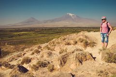 Traveler man visit Khor Virap Monastery. Mountain Ararat on background. Exploring Armenia. Armenian adventure. Tourism and travel. Concept. Religious landmark royalty free stock photography