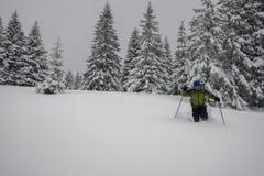 Traveler man is walking in deep snow Royalty Free Stock Photos
