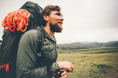 Traveler Man wayfaring in foggy mountains. Travel Lifestyle concept adventure active vacations outdoor hiking sport with backpack climbing equipment Stock Photo