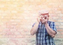 Traveler man wear plaid shirt with a camera. Royalty Free Stock Image