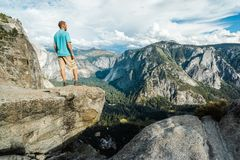 Traveler man in Yosemite National Park, scenic view at Valley and Mountains from Upper Yosemite Falls, California, USA royalty free stock photos