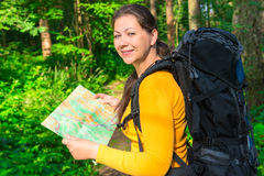 Traveler with a map in the forest. Happy traveler with a map in the forest Stock Photo
