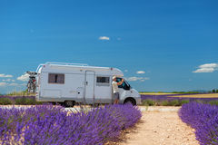 Traveler with mobile home at lavender fields in France Stock Image