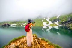 Traveler on the mountain lake Stock Photo
