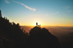 Traveler on mountain at sunrise Stock Image