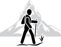 Traveler among the mountains. Icon Stock Photography