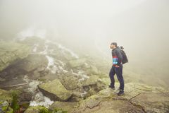 Traveler in mountains Royalty Free Stock Photo