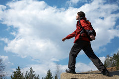 Traveler moves through the mountains Royalty Free Stock Photography