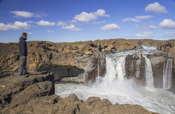 Traveler near Aldeyjarfoss Waterfall Stock Photo