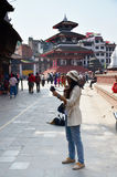 Traveler and nepalese people travel and take photo Basantapur Durbar Square Stock Images