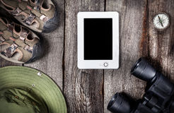 Traveler outfit. And tablet on the wooden background Stock Photos
