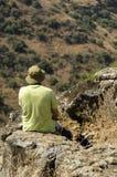 Traveler overlooking wadi Royalty Free Stock Images