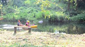 Traveler paddle kayak or canoe  in morning stock footage