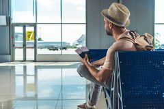 Traveler with passports and tickets. Waiting for someone in airport Stock Images