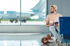 Traveler with passports and tickets. Waiting for someone in airport Stock Photos