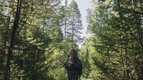 Traveler photographing scenic view in forest. One caucasian woman shooting nice magic look. Girl take photo video on