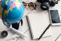 Traveler planning trip on notebook and smart phone. Travel concept stock photo
