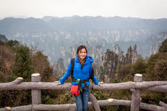 Traveler post for picture took at Zhangjiajie national park, Hunan province, China. Royalty Free Stock Photos