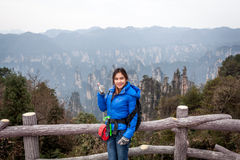 Traveler post for picture took at Zhangjiajie national park, Hunan province, China. Stock Images