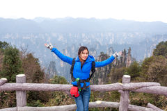 Traveler post for picture took at Zhangjiajie national park, Hunan province, China. Royalty Free Stock Photography
