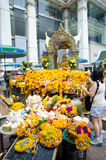 Traveler pray respect to the four-faced Brahma statue in Bangkok Stock Photo