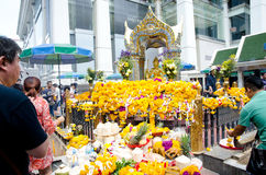 Traveler pray respect to the four-faced Brahma statue in Bangkok Royalty Free Stock Image
