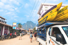 Traveler prepare travel by boat on in Vang Vieng, Laos. Vang Vieng, Laos - February 17, 2017: Traveler prepare travel by boat on in Vang Vieng, Laos. Vang Vieng stock images