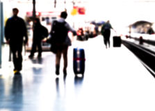 Traveler in railway station, blurred Royalty Free Stock Photography
