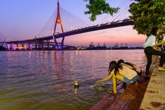 Traveler ready to Loy Kratong Festival at Wat Darn Temple Waterfront Royalty Free Stock Photos