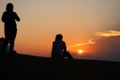 Traveler relax sunset Royalty Free Stock Image