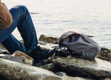 Traveler resting on coastline Royalty Free Stock Photos