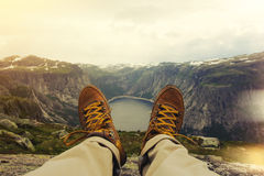 Traveler resting on a mountain plateau. POV view, legs close up on the background of mountain landscape Stock Photography