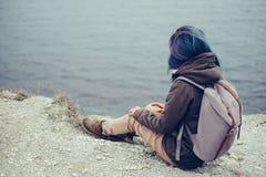 Traveler resting on steep coast Stock Photos