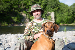 Traveler with a Rhodesian Ridgeback Stock Images