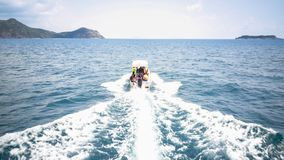Traveler ride on speed boat, moving to island. Gulf of Thailand royalty free stock photography