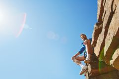 Traveler on rock Stock Images