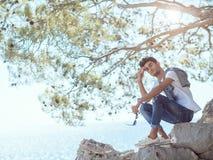 Man traveler near the sea Stock Photo