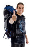Traveler with rucksack and thumbs up. On an isolated white background Stock Images
