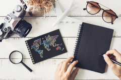 Traveler`s accessories and items with black notebook and copy sp Royalty Free Stock Images