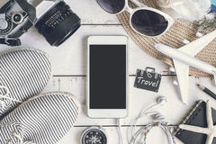 Traveler`s accessories and items. Overhead view of Traveler`s accessories, items and cellphone with copy space, Travel concept royalty free stock photos