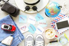 Traveler`s accessories and items, stickers with notes on white wooden background, planning travel to Europe by car on Easter holi. Day concept. Horizontal. Top Stock Image