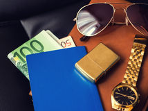 Traveler's accessory, passport, money, golden Stock Images