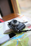 Traveler's camera smartphone and map Stock Images