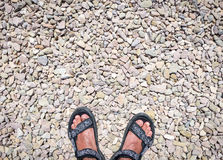 Traveler's feet on stone paved road wearing sandals Royalty Free Stock Image