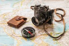 A traveler's kit. A map, an analog camera and a compass Stock Photos
