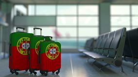 Travel suitcases featuring flag of Portugal. Portuguse tourism conceptual animation stock video footage