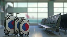 Travel suitcases featuring flag of South Korea. Korean tourism conceptual animation stock video