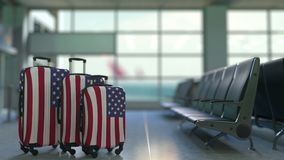 Travel suitcases featuring flag of the United States. American tourism conceptual animation stock video