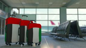 Travel suitcases featuring flag of the United Arab Emirates. UAE tourism conceptual animation. Traveler`s suitcases featuring flag. Tourism related 3D stock video