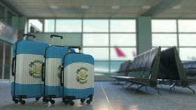 Travel suitcases with flag of Guatemala. Guatemalan tourism conceptual 3D animation. Traveler`s suitcases with flag. Tourism related 3D stock video
